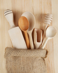 wooden kitchen utensils:spoons, rolling pin, scoop and honey dip
