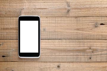 Smartphone on wooden background