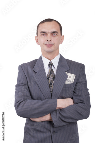 Young businessman in a suit and with dollars in his pocket.