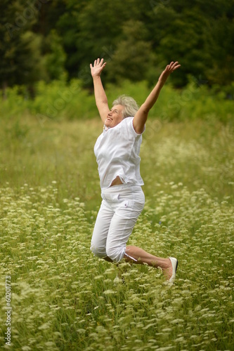 Elder woman smiling and jumping