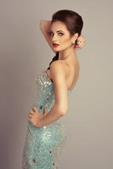 Pretty woman model in expensive evening diamond dress