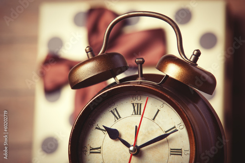 Retro clock and gift on the background.