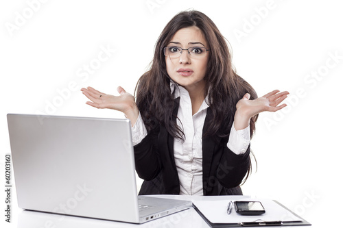 confused and beautiful young business woman at the desk