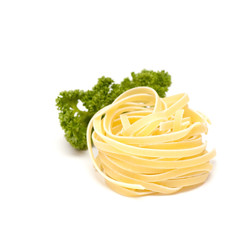 Italian pasta nest with parsley isolated on white