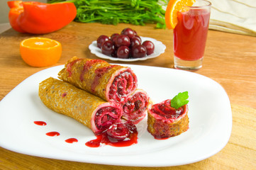 pancakes with cherry on a white plate