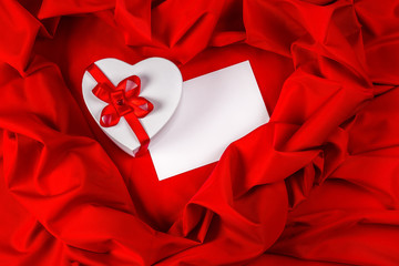 love greeting card with heart on a red fabric