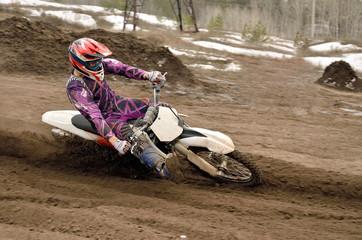Motocross rider turns point-blank of sand