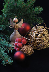 Christmas wooden angel with red and golden decoration