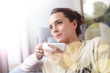 Leinwanddruck Bild - Peaceful woman relaxing at home with cup of tea