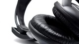 Black headphones on the white background. Closeup shot.
