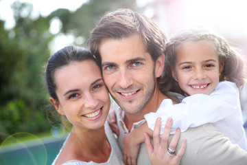 Sweet portrait of couple with little girl