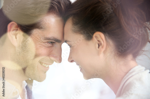 Profile of loving couple looking at each other