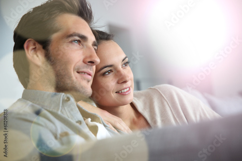 canvas print picture Couple at home relaxing in sofa