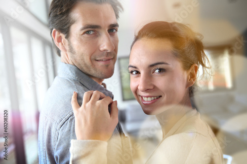 Portrait of smiling couple relaxing at home