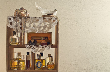 shelf on the wall with women's perfume