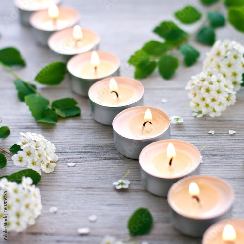 Burning candles and hawthorn blossom