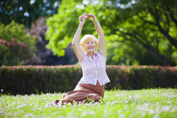 Mental Health. Optimistic Old Woman Exercising in Open Air