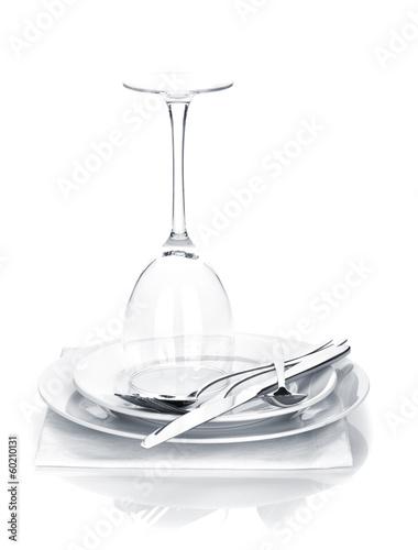 Leinwandbild Motiv Silverware or flatware set and wine glass over plates