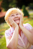 Elation. Ecstasy. Surprised Grey-Haired Senior Woman Looking Up poster