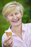 Contentment. Ecstatic Old Woman Holding Ice-Cream and Laughing