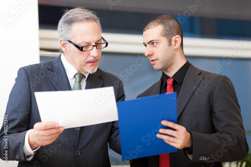 Couple of businessman discussing
