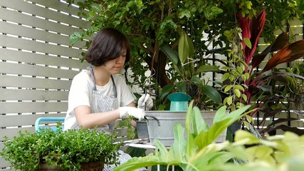 Asian woman working in garden