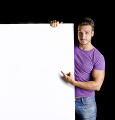 Handsome young man with large blank display