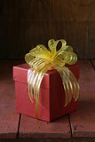 pink gift box with ribbon and decorations in vintage style