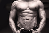 Close-up of muscular male torso, pecs, abs and arms poster
