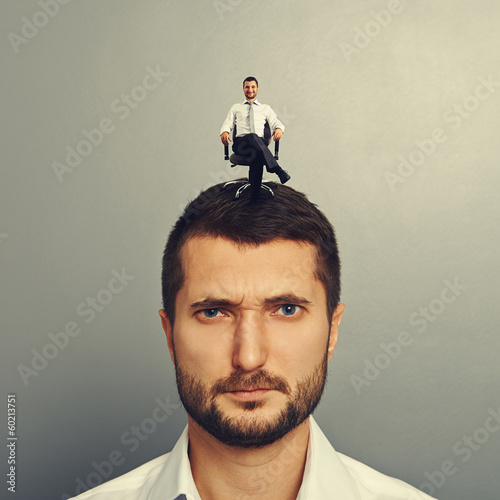 discontented man with happy man on the head