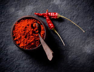 Red pepper spices on stone background