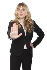 Businesswoman giving a halt gesture