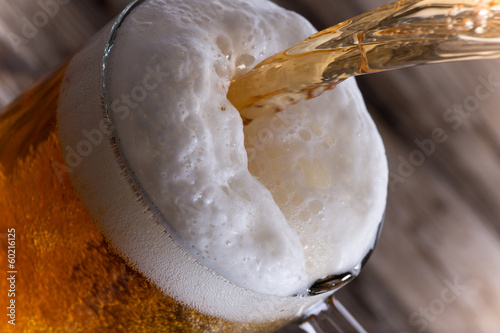 Fotobehang Bier Glass of beer, close-up