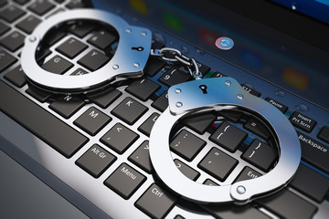 Handcuffs on laptop keyboard
