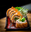 Sushi - traditional japanese food. Roll made of salmon
