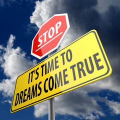 Stop it is time for dreams to come true words on road sign