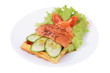 Belgian waffle with sliced salted salmon, tomatoes, cucumbers, l