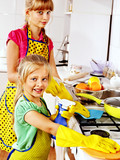 Children cleaning  kitchen.