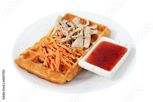 Belgian waffle with chicken and carrot salad.