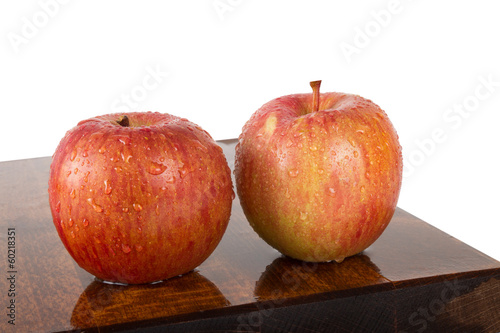 Fresh juicy water-sprinkled apples on white background