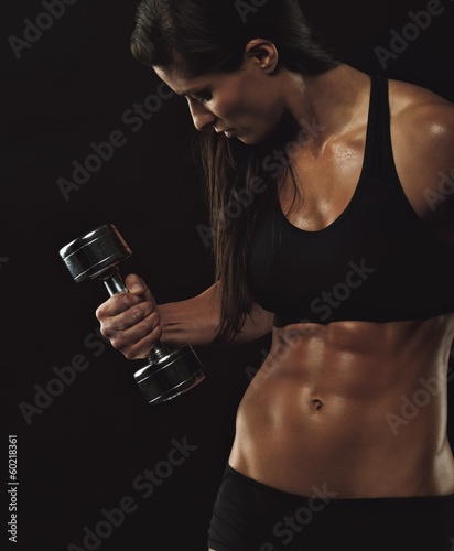 Female fitness model exercising