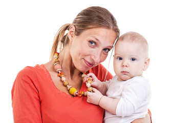 Young Caucasian woman and baby boy playing with nursing necklace