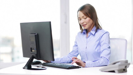 businesswoman with telephone and computer