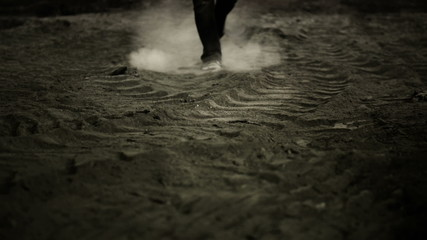 Movie Scene III. Man walking in dust