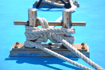 bollard with rope on deck of yacht