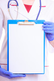 Part female body in lab coat. Doctor nurse with blank clipboard