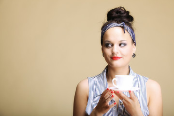 Hot beverage. Woman holding tea or coffee cup