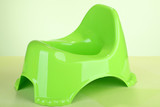 Green potty on color background