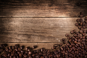 Coffee beans on wood texture background