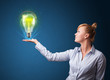 Glowing lightbulb in the hand of a businesswoman
